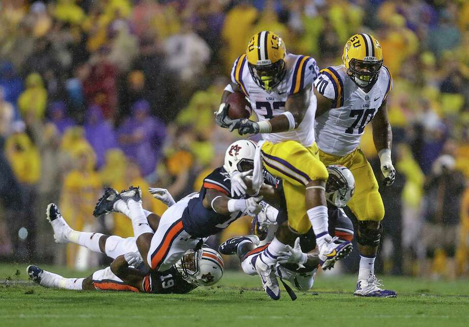 LSU's Jeremy Hill breaks free on a 49-yard touchdown run, the first of his scoring plays. Photo: Gerald Herbert, STF / AP