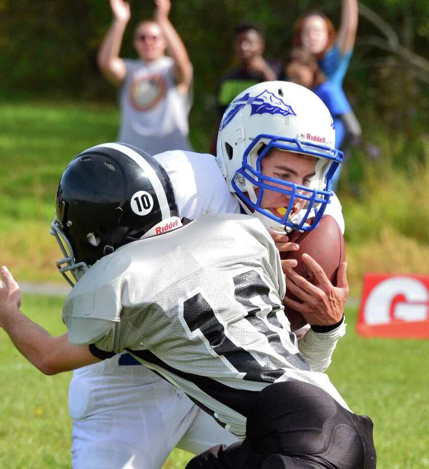 Hoosic Valley'S #3 Dan Joslin, top, catches a touch down pass during Saturday's game against Schoburg Sept. 21, 2013, in Duanesburg.  (John Carl D'Annibale / Times Union) Photo: John Carl D'Annibale / 00023947A