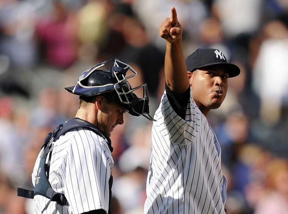 NEW YORK, NY - SEPTEMBER 21:  Ivan Nova #47 of the New York Yankees celebrates a win over the San Francisco Giants with Chris Stewart #19 during interleague play on September 21, 2013 at Yankee Stadium in the Bronx borough of New York City. The Yankees defeat the Giants 6-0. (Photo by Maddie Meyer/Getty Images) ORG XMIT: 163495675 Photo: Maddie Meyer / 2013 Getty Images
