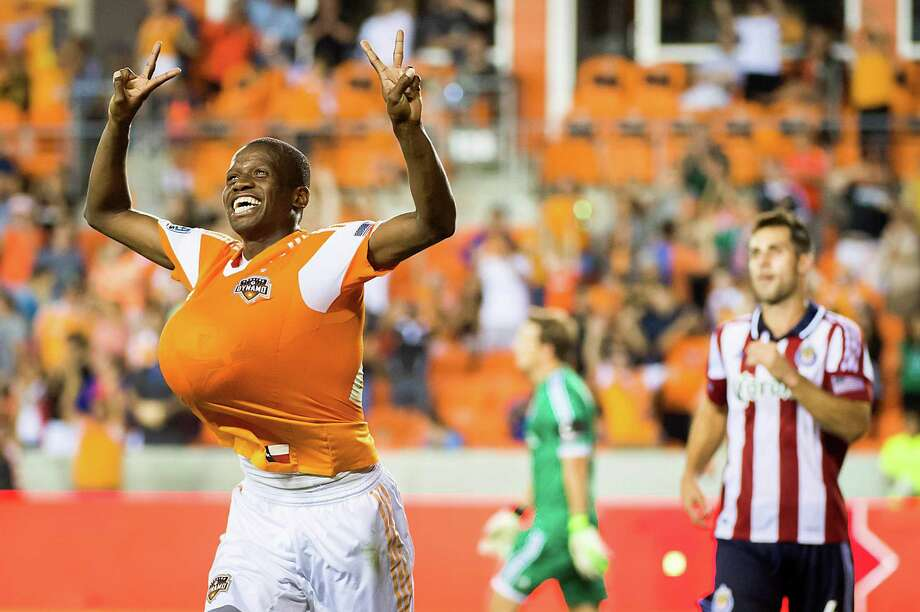 Houston Dynamo midfielder Boniek Garcia celebrates in front of Chivas USA defender Carlos Bocanegra after scoring on a penalty kick in the 90th minute at BBVA Compass Stadium on Saturday, Sept. 21, 2013 Photo: Smiley N. Pool, Houston Chronicle / © 2013  Houston Chronicle