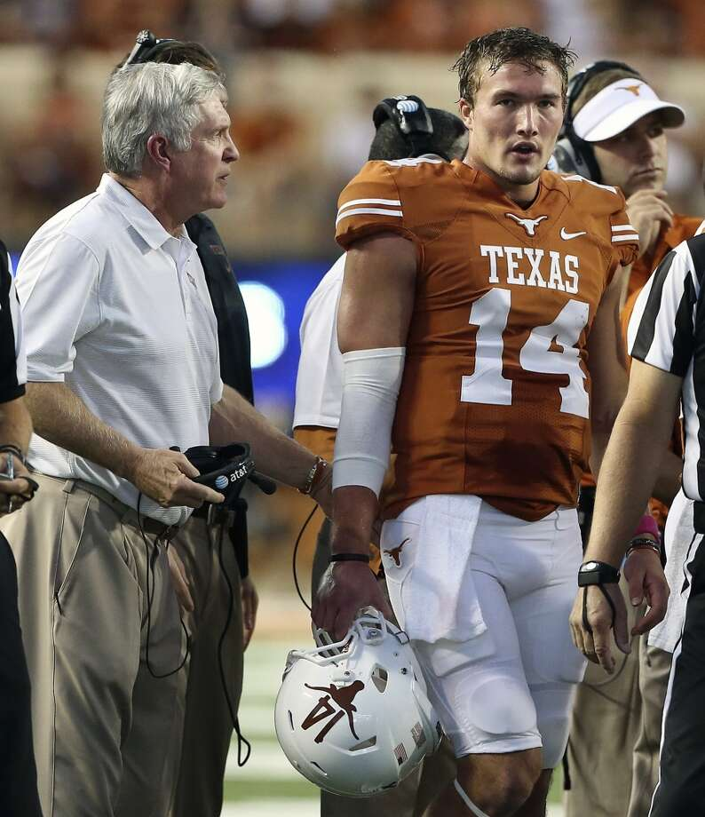 UT coach Mack Brown encourages his quarterback David Ash as Texas hosts Kansas State at Darrell K. Royal - Texas Memorial Stadium  on September 21, 2013. Photo: TOM REEL