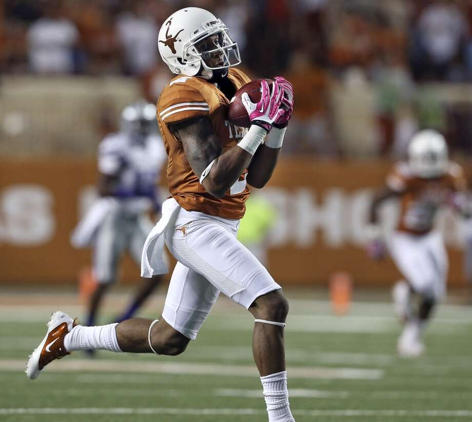 Kendall Sanders hauls in a long touchdown pass in the first quarter as Texas hosts Kansas State at Darrell K. Royal - Texas Memorial Stadium  on September 21, 2013. Photo: TOM REEL