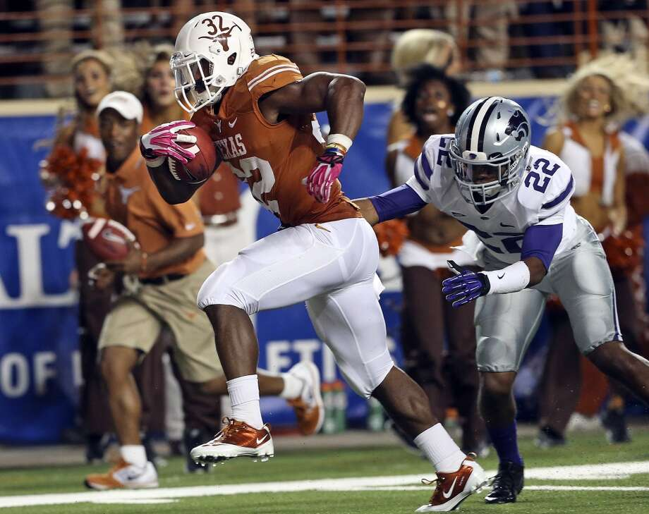 Johnathan Gray twists free of Dante Barnett to get in the end zone in the second quarter as Texas hosts Kansas State at Darrell K. Royal - Texas Memorial Stadium  on September 21, 2013. Photo: TOM REEL