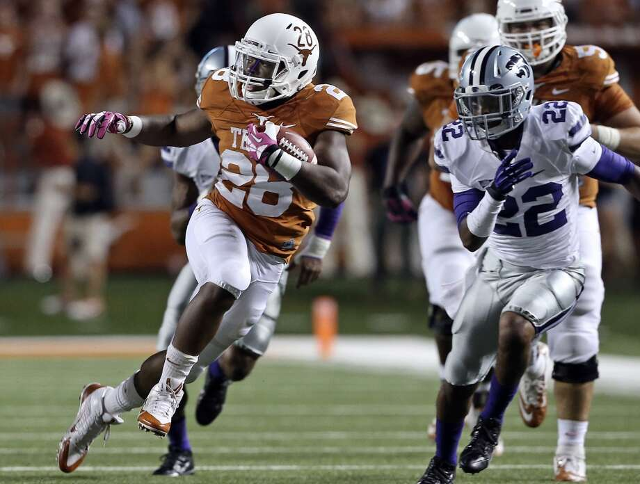 Malcolm Brown breaks for a long run to the left in the first half as Texas hosts Kansas State at Darrell K. Royal - Texas Memorial Stadium  on September 21, 2013. Photo: TOM REEL