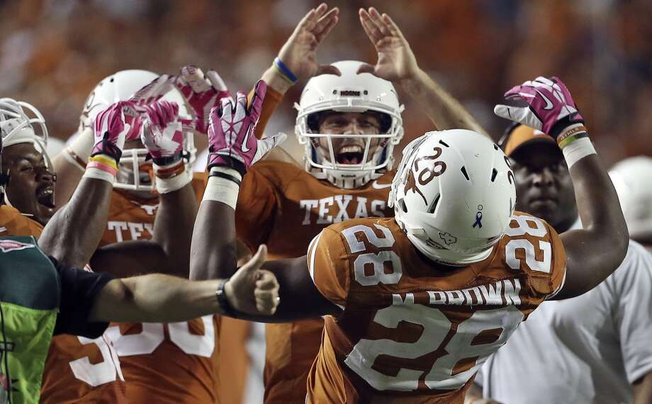 Longhorn teammates re-congratulate Malcom Brown after he runs the ball in for a touchdown to follow his earlier effort which was ruled just shy of the goal as Texas hosts Kansas State at Darrell K. Royal - Texas Memorial Stadium  on September 21, 2013. Photo: TOM REEL