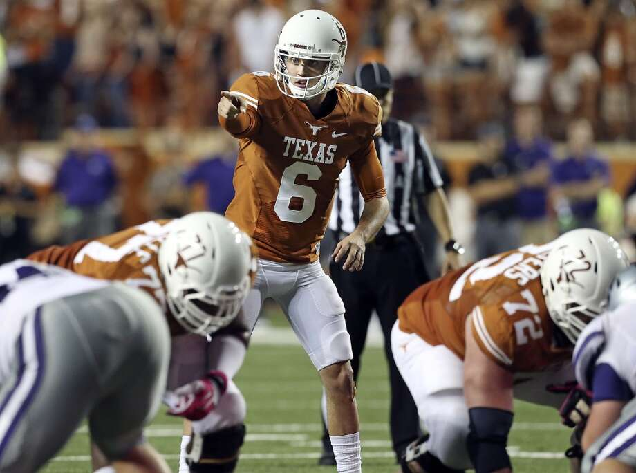 Case McCoy directs the Longhorn offense in the second half as Texas hosts Kansas State at Darrell K. Royal - Texas Memorial Stadium  on September 21, 2013. Photo: TOM REEL