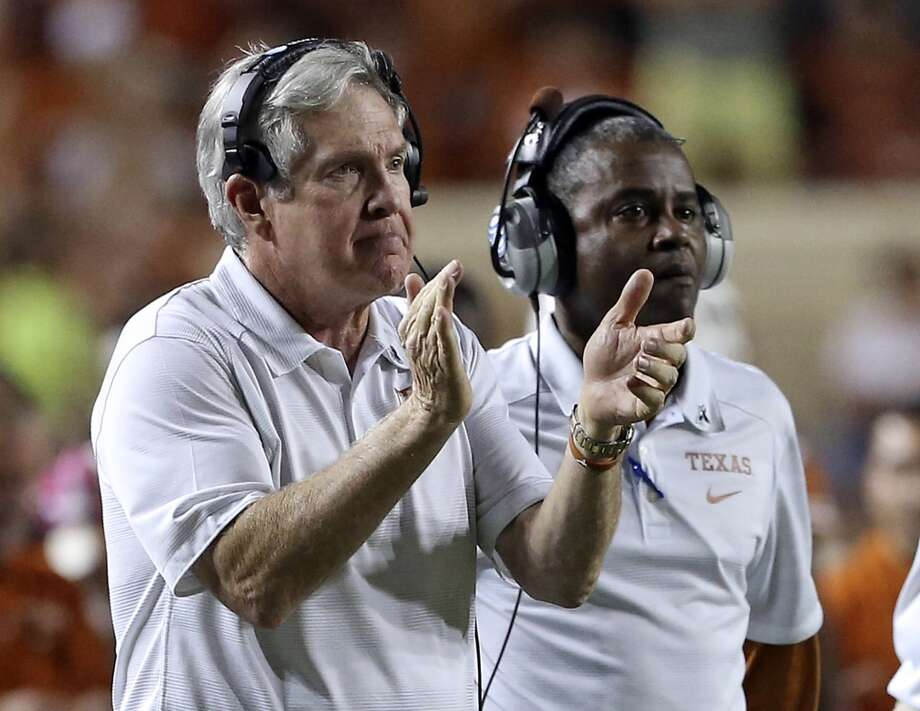Mack Brown applauds his team after a fourth quarter touchdown as Texas hosts Kansas State at Darrell K. Royal - Texas Memorial Stadium  on September 21, 2013. Photo: TOM REEL