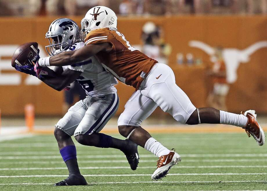 UT defender Adrian Phillips contests a screen pass to Wildcat receiver Tyler Lockett as Texas hosts Kansas State at Darrell K. Royal - Texas Memorial Stadium  on September 21, 2013.