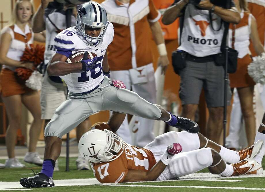 Tyler Lockett nearly breaks for a touchdown after a long reception over Longhorn defender Adrian Phillips in the fourth quarter Texas hosts Kansas State at Darrell K. Royal - Texas Memorial Stadium  on September 21, 2013. Photo: TOM REEL