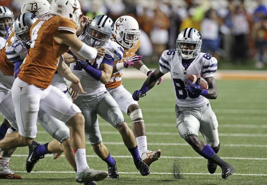 Tramaine Thompson brings the ball back to scoring position for KU in the final minute as Texas hosts Kansas State at Darrell K. Royal - Texas Memorial Stadium  on September 21, 2013. Photo: TOM REEL
