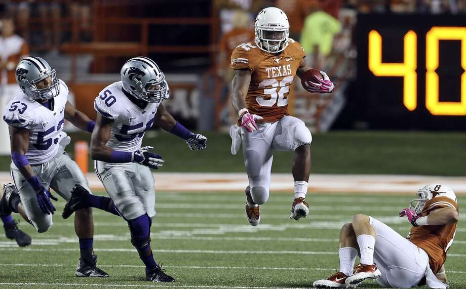 Johnathan Gray gets some air time on a run to the left in the third quarter as Texas hosts Kansas State at Darrell K. Royal - Texas Memorial Stadium  on September 21, 2013. Photo: TOM REEL