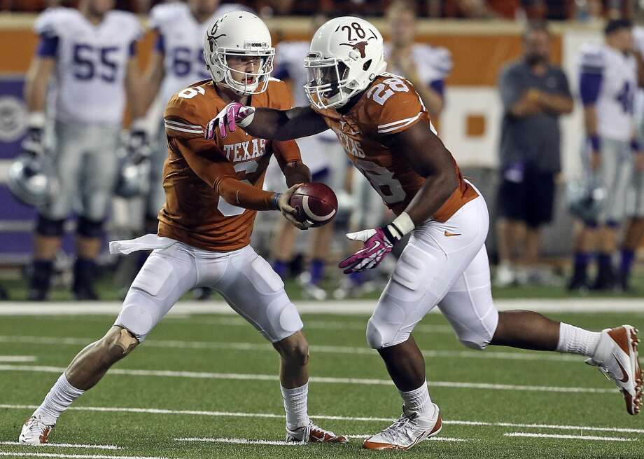 Case McCoy hands off to Malcolm Brown in the second half as Texas hosts Kansas State at Darrell K. Royal - Texas Memorial Stadium  on September 21, 2013. Photo: TOM REEL