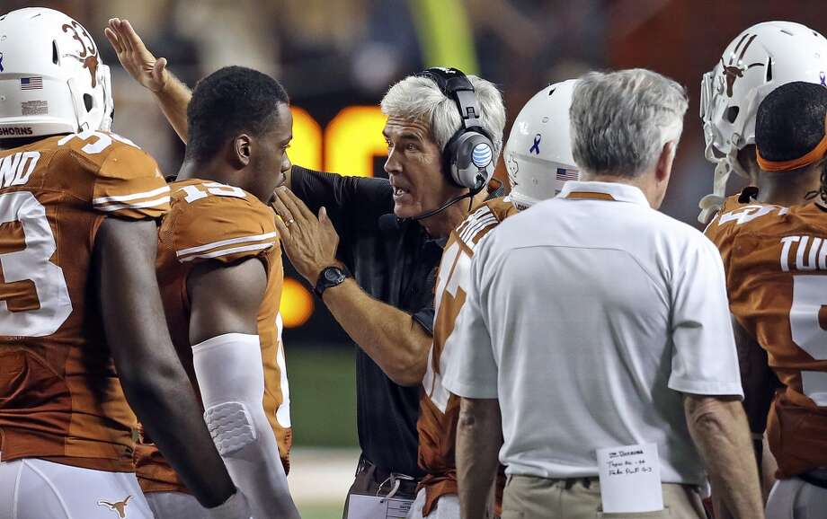UT defensive co-ordinator Greg Robinson gives instruction during a timeout as Texas hosts Kansas State at Darrell K. Royal - Texas Memorial Stadium  on September 21, 2013. Photo: TOM REEL