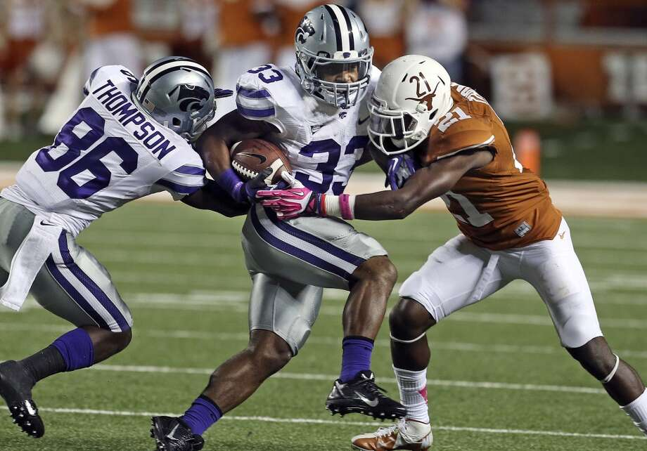 Longhorn defender Duke Thomas gets in to put the stop on Wildcat running back John Hubert in the second half as Texas hosts Kansas State at Darrell K. Royal - Texas Memorial Stadium  on September 21, 2013. Photo: TOM REEL