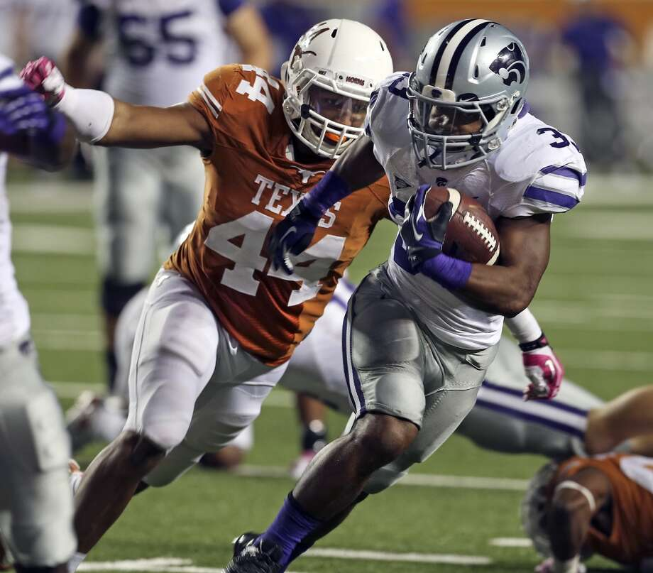 UT defensive end Jackson Jeffcoat stretches in to make the stop on John Hubert in the second half as  Texas hosts Kansas State at Darrell K. Royal - Texas Memorial Stadium  on September 21, 2013.