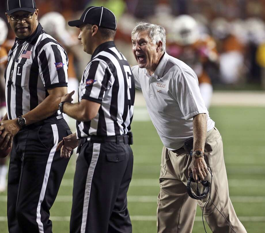 Mack Brown pleads for a call in the final minutes as the Wildcats threaten to score as Texas hosts Kansas State at Darrell K. Royal - Texas Memorial Stadium  on September 21, 2013.