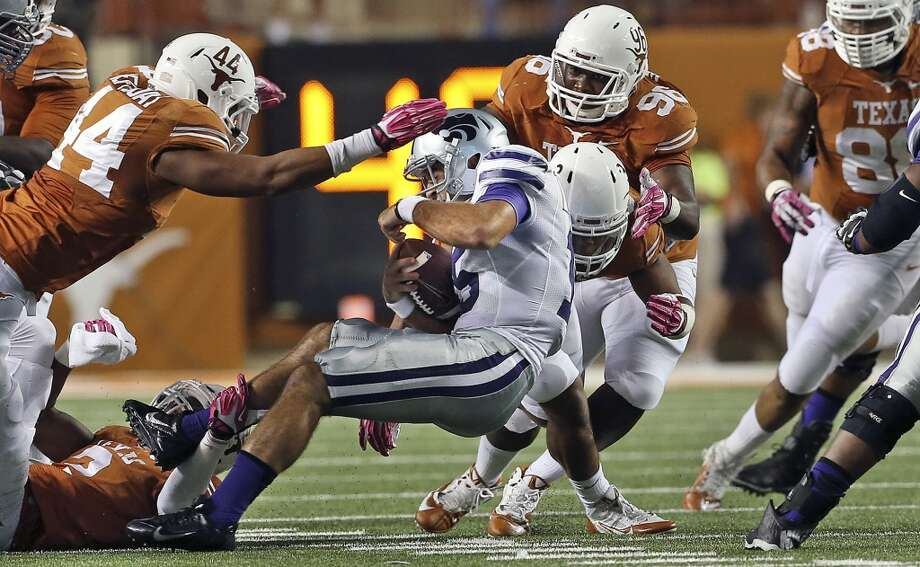 The Longhorn defense collapses in to sack Widcat quarterback Jake Waters as Texas hosts Kansas State at Darrell K. Royal - Texas Memorial Stadium  on September 21, 2013.