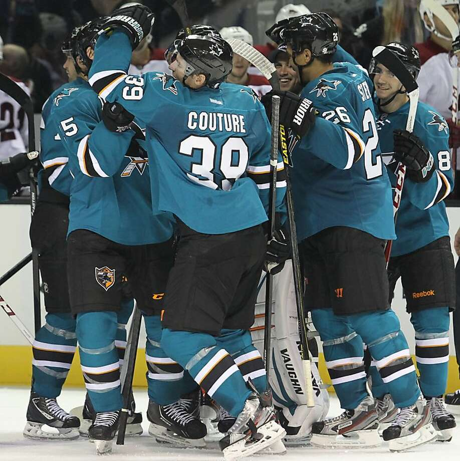 Sharks teammates congratulate Logan Couture for his game-winning goal against Phoenix. Photo: Mathew Sumner, Associated Press