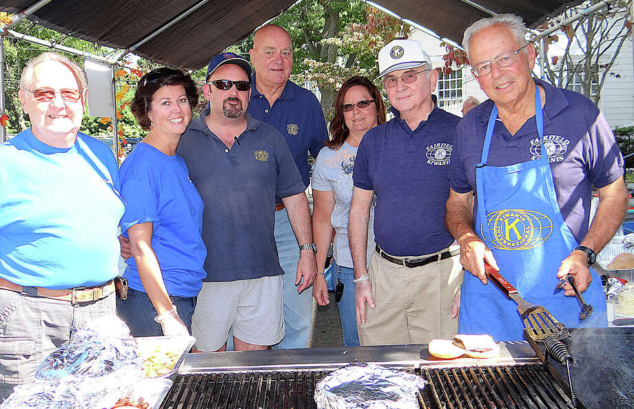 Staffing the food station at the Fairfield Kiwanis Club's Arts & Crafts Fair on Saturday were Bob Comers, Betsy Browne, John Hackett, Rich Cellar, Renee Ruggiero, Bob Erskine and Dick Vanderblue. Photo: Mike Lauterborn / Fairfield Citizen contributed