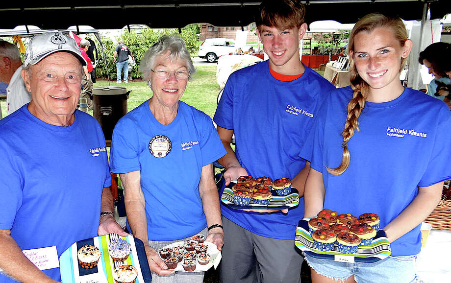 Selling baked goods at the Fairfield Kiwanis Club's Arts & Crafts Fair on Saturday were Bill Valus, Tove Vanderblue, Tom Luckner and Jackie Seymour. Photo: Mike Lauterborn / Fairfield Citizen contributed