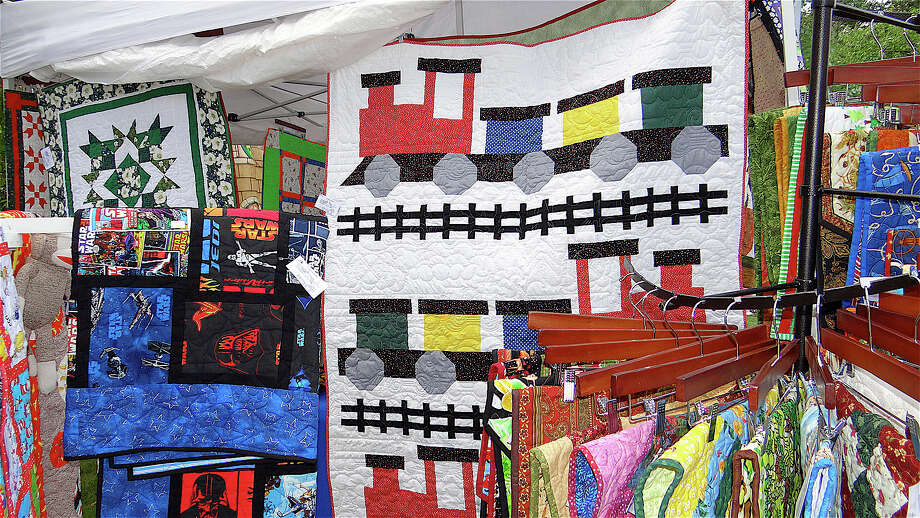 A colorful display by Lordship Quilts at the Fairfield Kiwanis Club's Arts & Crafts Fair on Town Hall Green. Photo: Mike Lauterborn / Fairfield Citizen contributed