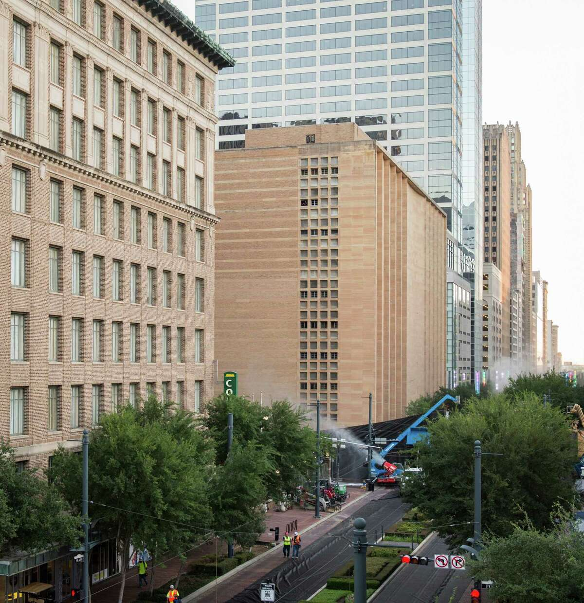 A series of explosive charges brings down the landmark former Macy's department store building in downtown Houston on Sunday, Sept. 22, 2013.