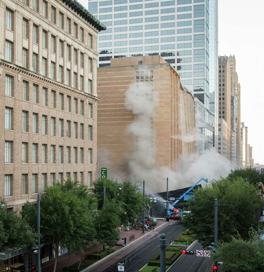 A series of explosive charges brings down the landmark former Macy's  department store building in downtown Houston on Sunday, Sept. 22, 2013. Photo: Smiley N. Pool, Houston Chronicle / © 2013  Houston Chronicle