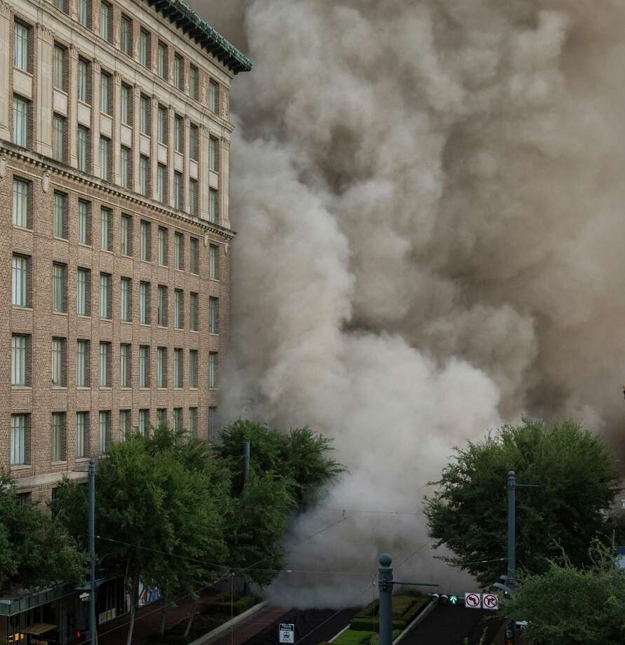 A series of explosive charges brings down the landmark former Macy's 