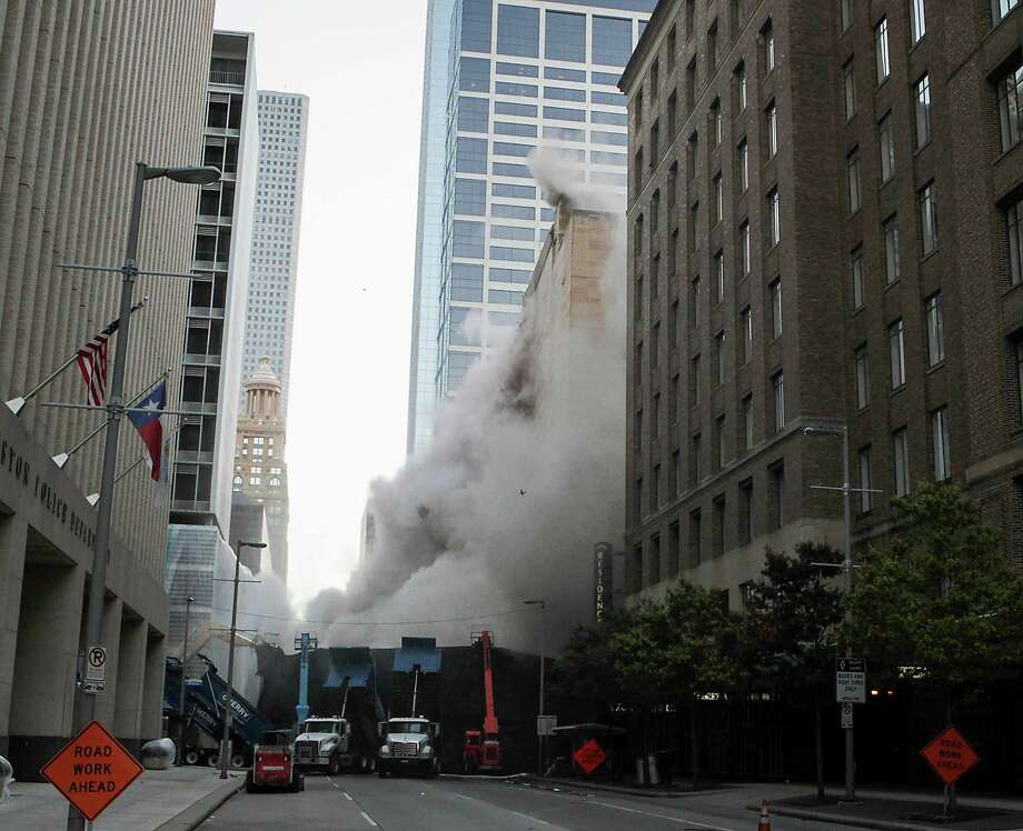 Explosive charges are detonated during the implosion of the Macy's building in downtown Houston on Sunday, Sept. 22, 2013. Photo: James Nielsen, Houston Chronicle / © 2013  Houston Chronicle