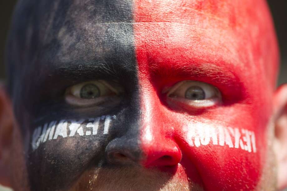 Texans fan A.J. Hicks shows off team colors in Baltimore. Photo: Brett Coomer, Houston Chronicle