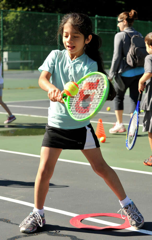 Maria Flores returns the ball during the USTA Free Tennis Play Event at Scalzi Park in Stamford on Sunday, Sept. 22, 2013. Photo: Jason Rearick / Stamford Advocate