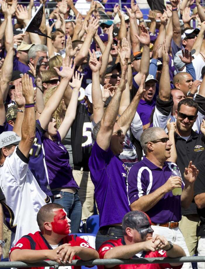 Ravens fans celebrate a touchdown while Texans fans look on disappointed. Photo: Brett Coomer, Houston Chronicle