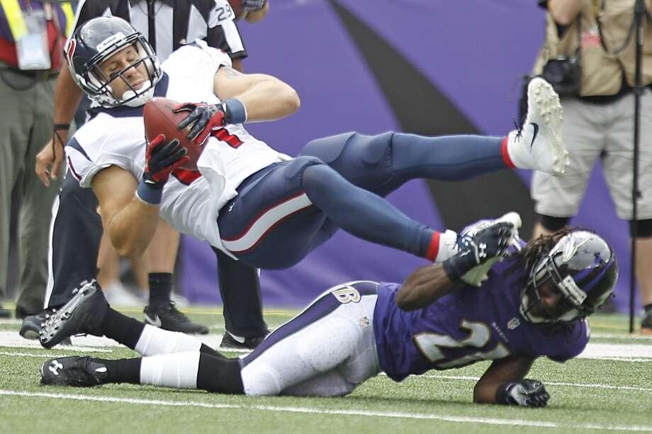 Texans tight end Owen Daniels makes a catch against the Ravens. Photo: Brett Coomer, Houston Chronicle