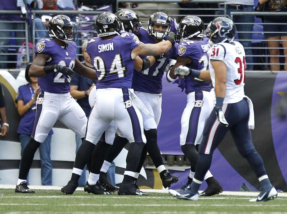 Tandon Doss of the Ravens is mobbed by teammates after returning a punt for a touchdown against the Texans. Photo: Brett Coomer, Houston Chronicle