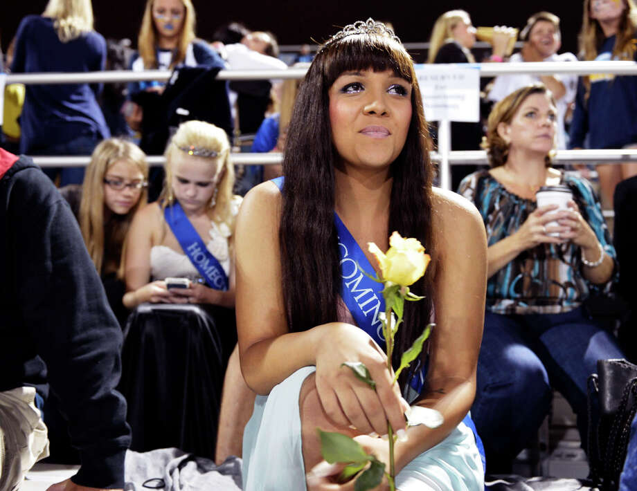 Cassidy Campbell, 16, attends the 2013 homecoming football game for Marina High School on Friday, Sept. 20, 2013 in Huntington Beach, Calif.  Campbell was crowned 2013 homecoming queen for Marina High School.  Upon receiving her crown, Cassidy became the Marina High School's 50th homecoming queen and one of few transgendered teens nationwide to receive such a title. It also marked a lengthy road traveled toward acceptance by her peers and her self. (AP Photo/The Orange County Register, Stuart Palley)  Photo: AP