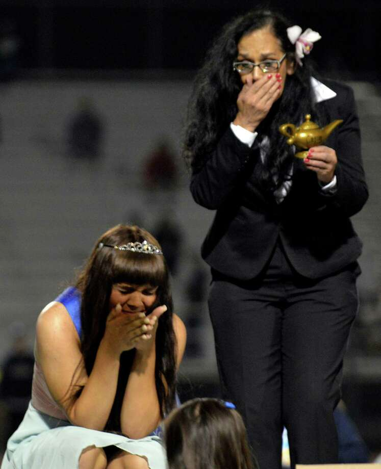 Cassidy Campbell, 16, left, and her mother Christina Campbell, right, react after Cassidy is crowned 2013 homecoming queen for Marina High School on Friday, Sept. 20, 2013 in Huntington Beach, Calif.   Upon receiving her crown, Cassidy became the Marina High School's 50th homecoming queen and one of few transgendered teens nationwide to receive such a title. It also marked a lengthy road traveled toward acceptance by her peers and her self. (AP Photo/The Orange County Register, Stuart Palley) Photo: AP