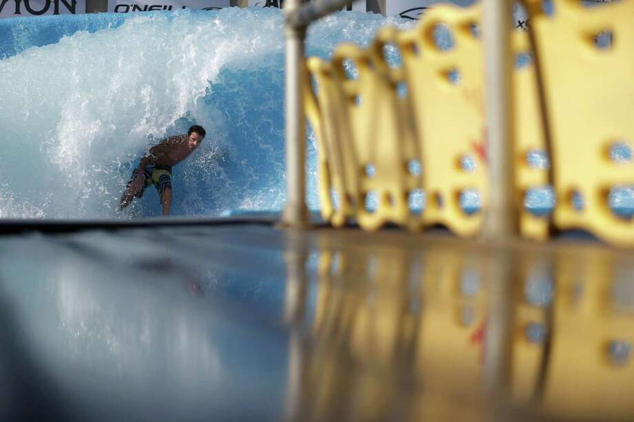 A surfer rides the machine-made wave at Wavehouse San Diego Wednesday, Sept. 18, 2013, in San Diego. Surf parks - massive pools with repeating, artificial waves - are the latest buzzword in the surf community. Momentum around surf parks has been growing since the 1960s and but fewer than a dozen serious parks currently exist in locations from Florida to Malaysia _ and cost and wave technology have always been stumbling blocks. Photo: AP