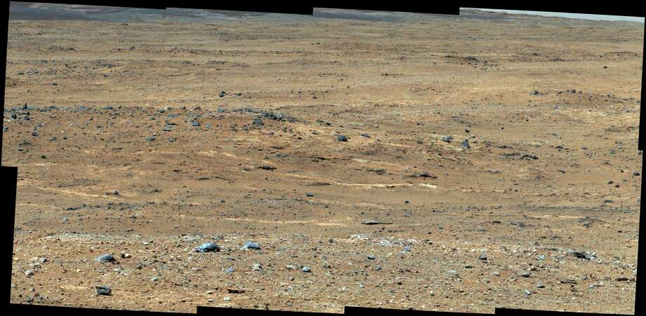 This Sept. 7, 2013 image provided by NASA, taken by NASA's Curiosity rover shows a view of Gale Crater near the Mars equator. Experiments by Curiosity found no trace of methane gas in the Martian atmosphere, according to a study released on Thursday, Sept. 19, 2013. Photo: AP