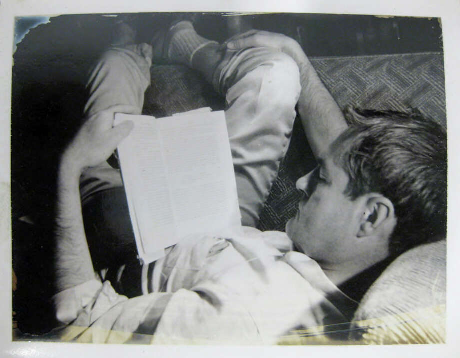 In this circa 1961 file photo provided by the New York Public Library, a curled-up Timothy Leary reads a book. Leary saved thousands of documents, correspondence and writings relating to his scientific research into psychedelic drugs in the 1960s, much of it never published but now available to scholars and the public at the New York Public Library, which purchased the collection  in 2011 from the Leary estate. Photo: AP