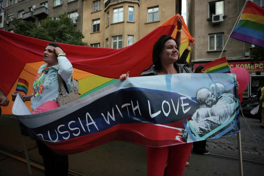 "Demonstrators hold a poster reading ""To Russia with love"" during the Sixth Sofia Gay Pride Parade in Sofia, Saturday, Sept. 21, 2013. Several hundred people have marched for gay rights in Bulgaria and protested against Russia's homosexuality policies. Photo: AP"