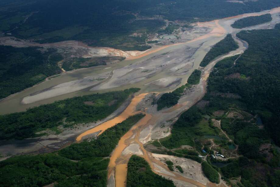 This Sept. 13, 2013 aerial photo shows a river polluted by waste from informal mining in Peru's Madre de Dios region. A study of mercury contamination from rampant informal gold mining in Peru's Amazon says indigenous people who get their protein mostly from fish are the most affected, particularly their children. A quarter of the subjects work in the region's wildcat alluvial gold mining industry, where an estimated 35 metric tons a year of mercury is used to bind together gold flecks. The mercury is then burned off and enters the environment. Photo: AP