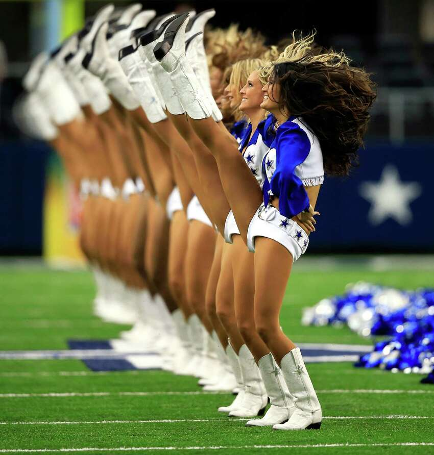 ARLINGTON, TX - SEPTEMBER 22: The Dallas Cowboys cheerleaders perform during the game against the St. Louis Rams at AT&T Stadium on September 22, 2013 in Arlington, Texas.