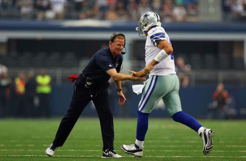 ARLINGTON, TX - SEPTEMBER 22:  Head coach Jason Garrett celebrates a touchdown with Tony Romo #9 of