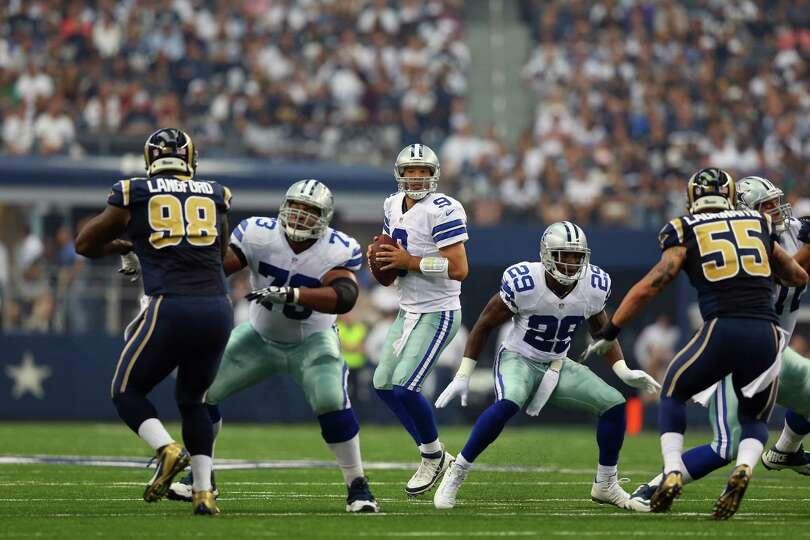 ARLINGTON, TX - SEPTEMBER 22:  Tony Romo #9 of the Dallas Cowboys throws against the St. Louis Rams