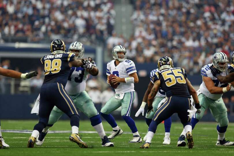 ARLINGTON, TX - SEPTEMBER 22:  Tony Romo #9 of the Dallas Cowboys throws against the St. Louis Rams