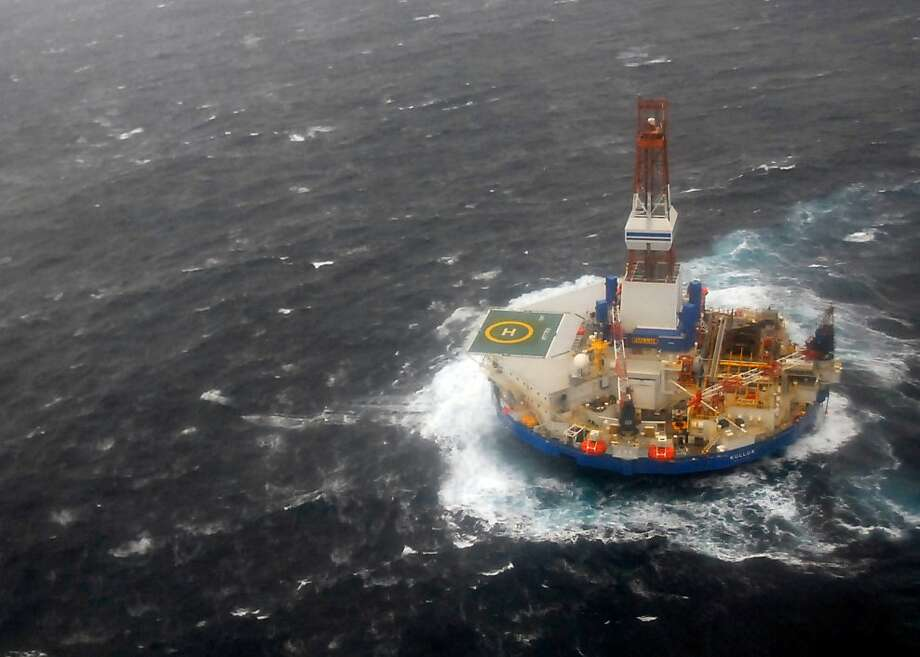 The mobile drilling unit Kulluk, which ran aground in the Gulf of Alaska in December 2012, is towed by the tugs Aiviq and Nanuq in 29-mph winds and 20-foot seas 116 miles southwest of Kodiak City, Alaska. Photo: Associated Press
