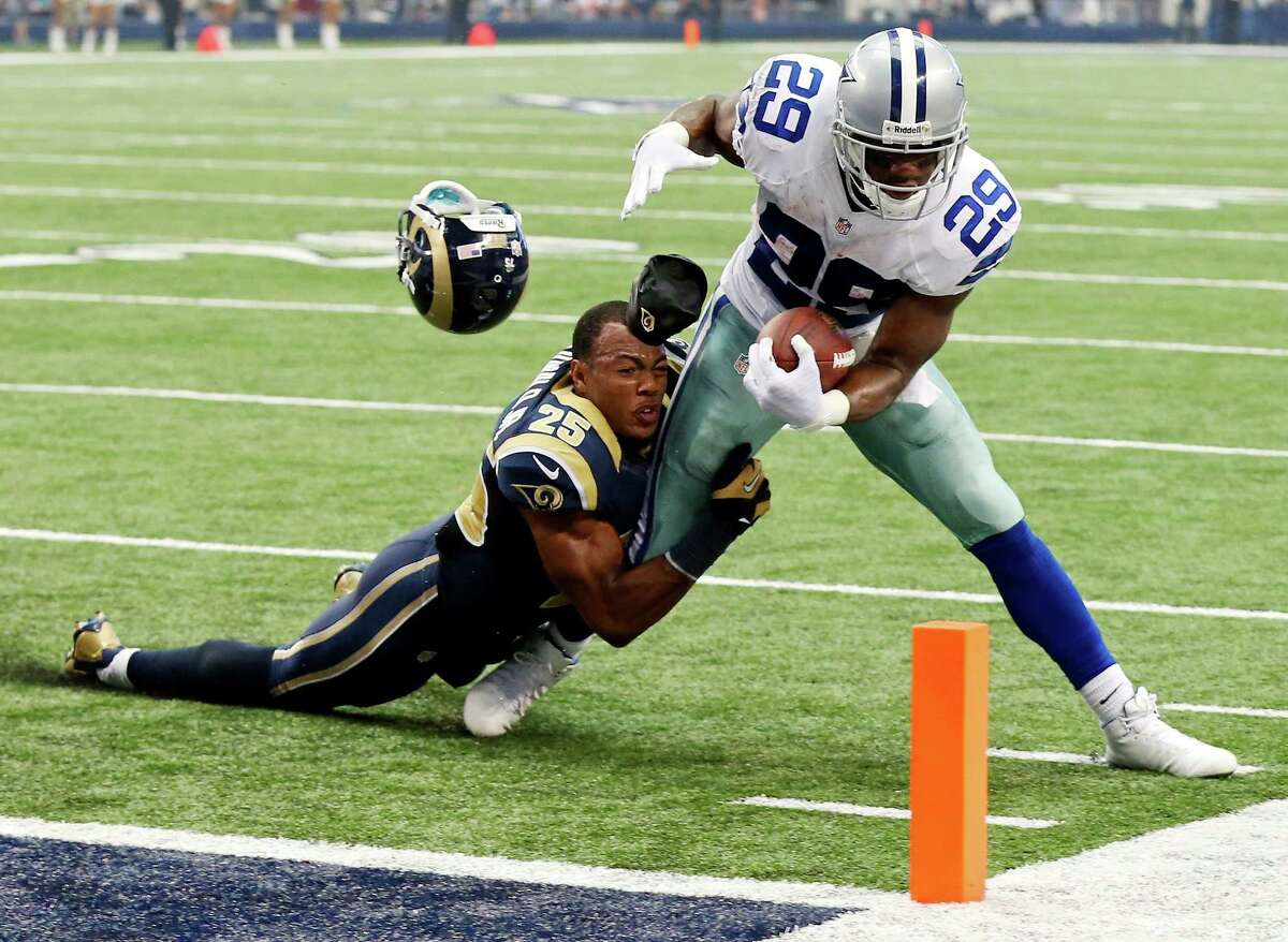 Dallas Cowboys' DeMarco Murray heads to the end zone for a touchdown against St. Louis Rams' T.J. McDonald during first half action Sunday Sept. 22, 2013 at AT&T Stadium in Arlington, Tx.