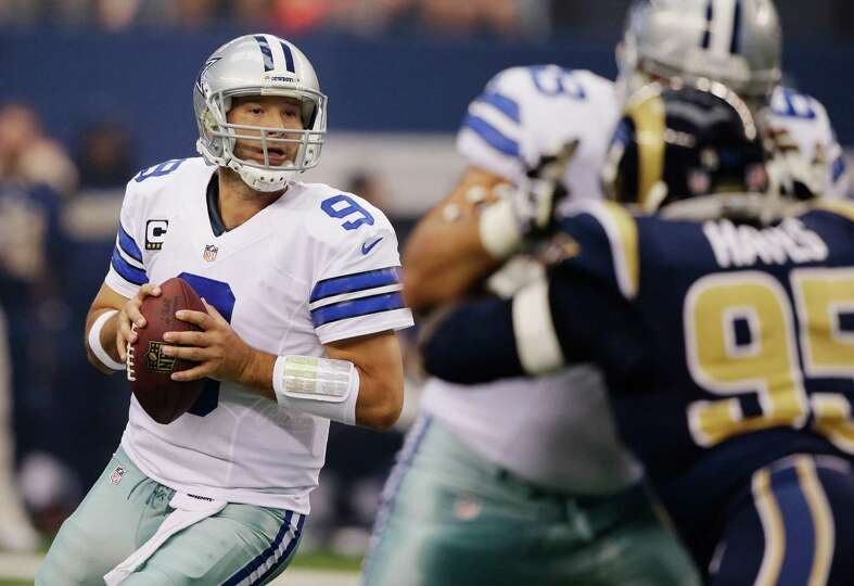 Dallas Cowboys quarterback Tony Romo (9) rolls back to pass against the St. Louis Rams during the fi