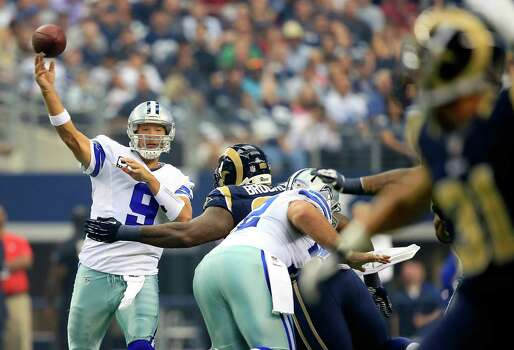 ARLINGTON, TX - SEPTEMBER 22:  Quarterback Tony Romo #9 of the Dallas Cowboys passes during the game against the St. Louis Rams at AT&T Stadium on September 22, 2013 in Arlington, Texas. Photo: Jamie Squire, Getty Images / 2013 Getty Images