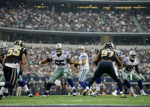 Dallas Cowboys quarterback Tony Romo (9) passes against the St. Louis Rams during the second quarter of a NFL football game Sunday, Sept. 22, 2013, in Arlington, Texas. (AP Photo/Tony Gutierrez) Photo: Tony Gutierrez, Associated Press / AP